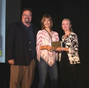 Judy Albers accepts LDC awards for Intrepid