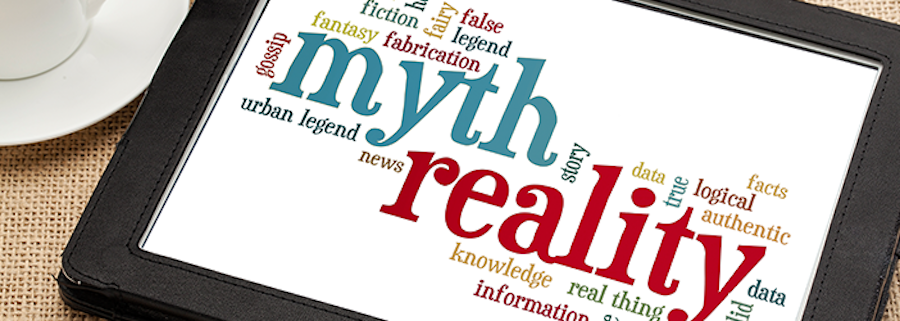 """Tablet with word cloud including """"Myth"""" """"Reality"""" """"News"""" """"Information"""" etc."""